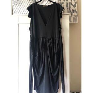 Sleek black fancy dress with cap sleeves